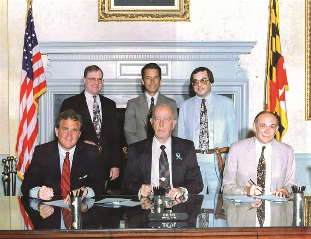 Back row (L-R): Sen. Laurence Levitan, chair, Budget and Taxation Committee; Michael DeLorenzo, vice president of International Franchise Systems, assistant to chair of Budget Committee. Front row (L-R):  Mike Miller, Senate president; William Donald Schaefer, governor of Maryland; and Clayton Mitchell, speaker of the House of Delegates, at the signing of Senate Bill 732, which replaced the need for rental car companies to pay titling tax with a use tax.