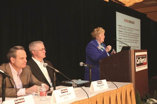 Sharon Faulkner (at podium) and the other members of the American Car Rental Association Board (l to r: Gordon Reel, Greg Scott) addressed the legislative issues facing the car rental industry, including the recent passage of the recall bill. Photo by Steve Reed.