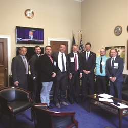 "The ""West"" delegation visited the offices of U.S. Rep. Jason Chaffetz (R-Utah) (right of flag). Chaffetz explained the importance of face-to-face interaction to understand the issues. He said peer-to-peer issues would likely be taken up by the House Committee on Science, Space, and Technology."