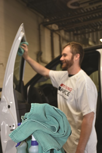 Eliminating the need to clean with disposable towels, Driving Force Vehicle Rentals, Sales, and Leasing provides employees with cloth rags for vehicle washing. Photo courtesy of Driving Force.