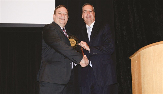 At the 2013 Auto Rental Summit, Rick Garlick of J.D. Power and Associates (left) presented National Car Rental with the top prize from its 2013 North American Rental Car Satisfaction Study. Alan Levine of Enterprise Holdings (right) accepted the award.