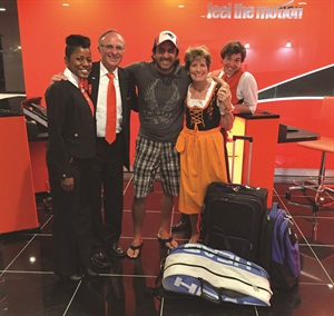 Owners Paula and Jack Vercollone and two rental agents pose with the first customer to the new Sixt Logan International Airport location.