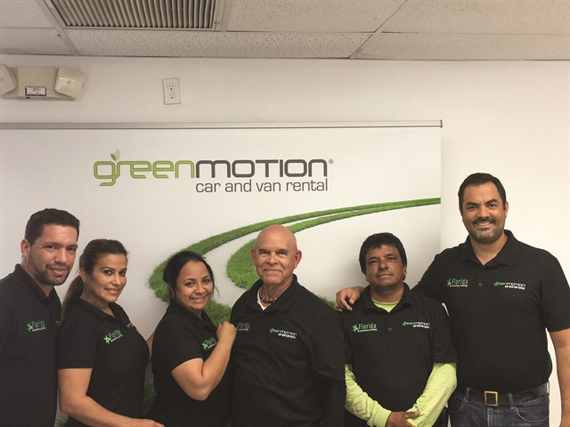 Patricio Franulic (far right) runs the master franchise for the state of Florida. After joining Green Motion, his independent rental company grew from 45 vehicles to about 300 in less than a year. Photo courtesy of Patricio Franulic.