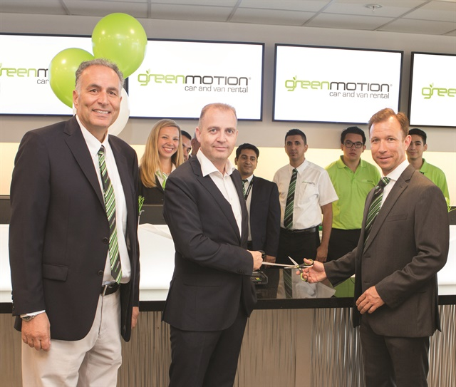 Green Motion opened its first California franchise location at the San Diego International Airport in July. Founder and CEO Richard Lowden (center) holds the ribbon while new franchisee Xavier Ortiz-Mena, CEO, gets ready to cut it during the opening ceremony on July 1, 2016. Photo courtesy of Green Motion.