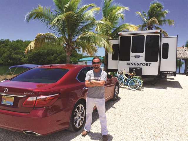 Matthew Holowinski, owner of Greenberg Rent A Camper, poses near one of his rental trailers.