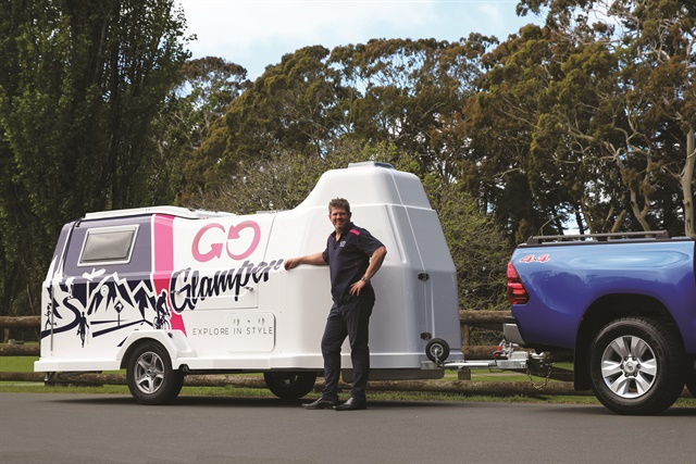 "James Dalglish, general manager at GO Rentals in New Zealand, poses with the GO Glamper camper trailer. ""This is an excellent diversification for GO in a highly competitive market,"" he says. Photo courtesy of GO Rentals."