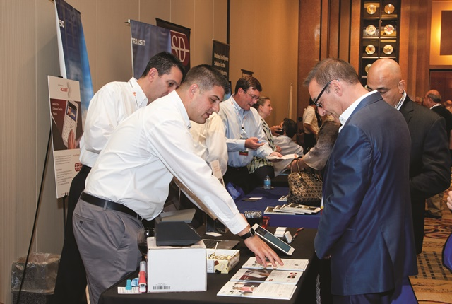 Attendees in the exhibit hall at last year's Auto Rental Summit. Photo by Joseph Cancellare.