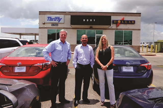 Working with several lenders, including 1st Source Bank, has helped Monty Merrill (left) expand his fleet at his Dollar Thrifty franchise locations. Merrill is pictured with Danny Owens, city manager, and Rene Mitchell, director of administration, at the Austin service center.