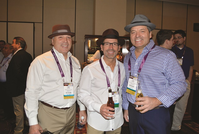 Bob (left), Chris, and Joe Darpino of Christy's Car & Truck Rental in Johnston, RI mingle at Monday evening's welcome reception cocktail hour.