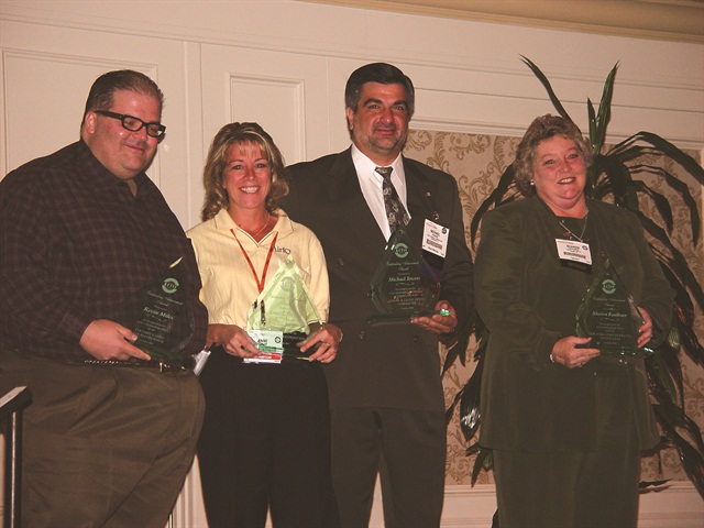 (L-R) Kevin Miles of Budget Columbus, Anne Taylor of AirIQ, Michael Towers of Fleet Financial Corp., and Thrifty licensee Sharon Faulkner receive outstanding achievement awards.