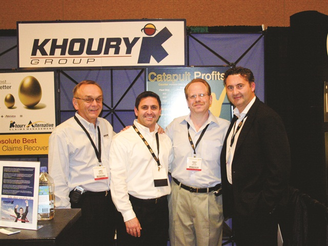 (L-R) Jim Bascom, Brian Aprati, Randy Harris and Ziad Khoury, all from Khoury Consulting, stand in front of their showroom booth at the 2006 show.