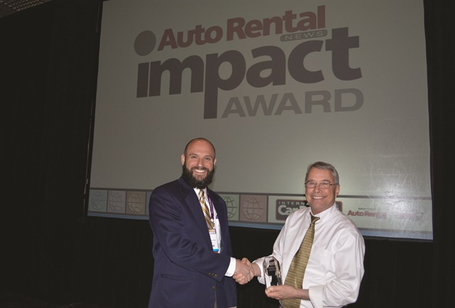 Michael DeLorenzo, executive vice president of International Franchise Systems (right), received the Auto Rental News Impact Award. Jon Dill, contact center director at IFS, presented DeLorenzo with the award.
