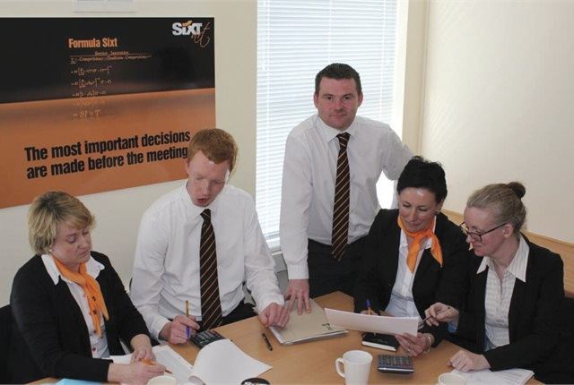 Stephen Kinsella (standing) finance and administration manager, joined the franchise three years ago in the middle of Ireland's financial collapse.