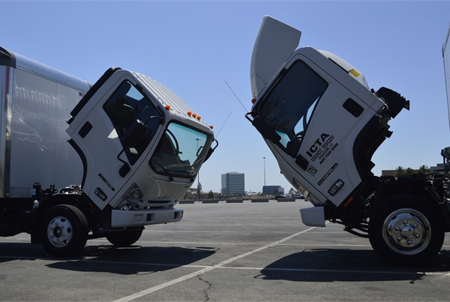 """Bow to your partner."" The Isuzu NPR diesel model (left, 12,000 lbs. GVWR) squares off with its gas (13,000 lbs. GVWR) counterpart."