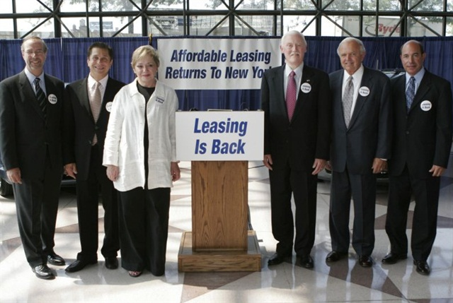 Elaine celebrates the passage of the Graves Amendment that paved the way for the return of leasing in New York state in 2005. She is flanked by members of the Greater New York National Automobile Dealers Association (GNYADA) and New York Sen. Owen Johnson, to her left.