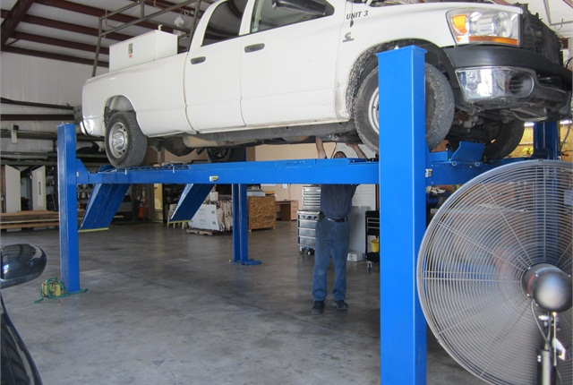 Dallas Gutter King's in-house maintenance initiative is centered around this vehicle lift, purchased for $12,000. Kulp admits he could have bought one used for half that price.