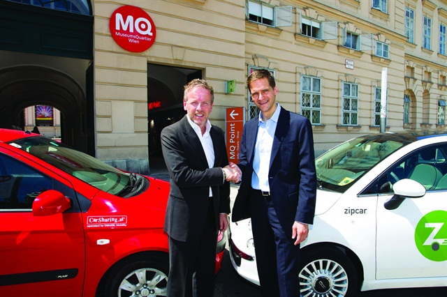 Frerk-Malte Feller, president of Zipcar Europe (right) shakes hands with Christof Fuchs, managing director of Denzel Mobility CarSharing GmbH, after Zipcar's acquisition of CarSharing.at in Austria on July 11, 2012. (PRNewsFoto/Zipcar Inc.)