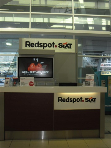 Adelaide Airport with both Redspot and Sixt logos.