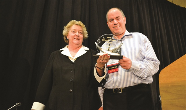 Gil Cygler received the 2012 Russell Bruno Award. Sharon Faulkner, executive director of ACRA, presented the award.