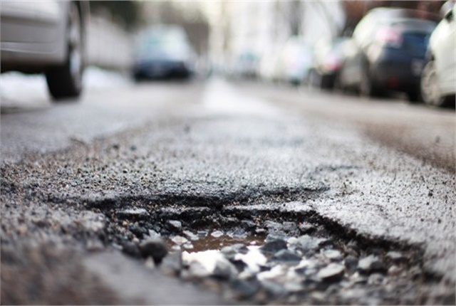 Photo of crumbling road courtesy of AAA.