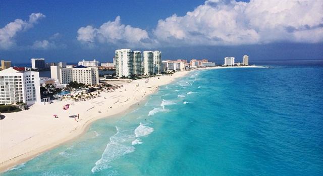 The beach in Cancun, Mexico. Photo via Wikimedia.