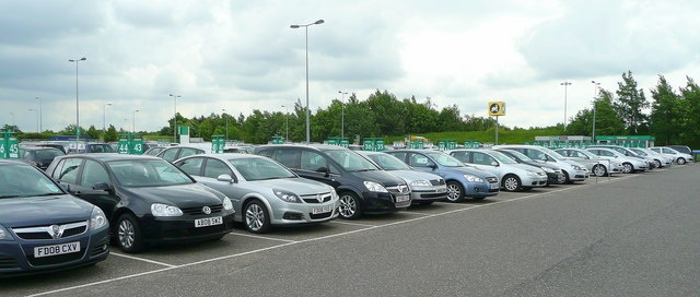 Car rental lot at an airport in the U.K. Photo via Wikimedia.