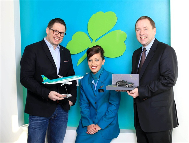 CarTrawler CEO Mike McGearty (left) is pictured with Ciara Byrne, Aer Lingus cabin crew, and Stephen Kavanagh, Aer Lingus' chief strategy and planning officer.