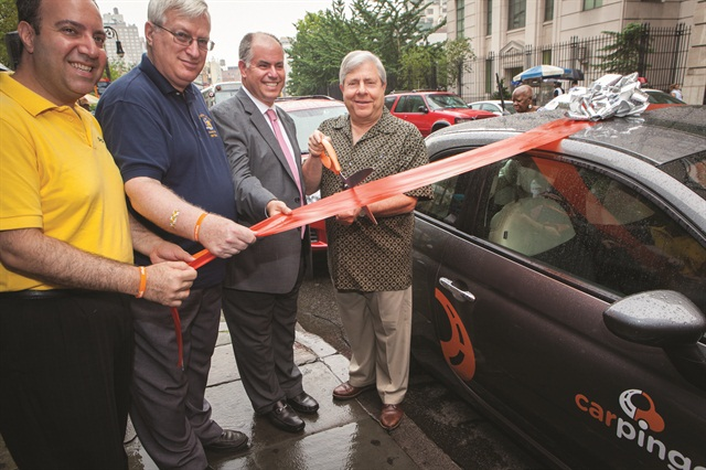 Gil Cygler (second to right) facilitates the ribbon cutting to launch the Carpingo carsharing service in 2012 with Brooklyn dignitaries and legislators.