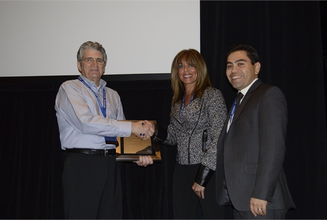 Stan Levy presents Beth Eidman and Jorge Arevalo with the Renter Rated Award for Midway Car Rental.