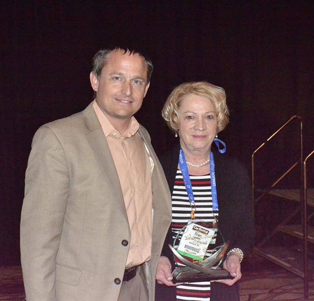 Chris Brown, executive editor of Auto Rental News, congratulates Doris Cassan.