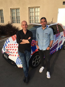 Co-founders Ori Sagie (left) and Aric Ohana stand in front of Envoy's branded community manager vehicle at the company's launch event in Culver City, Calif.