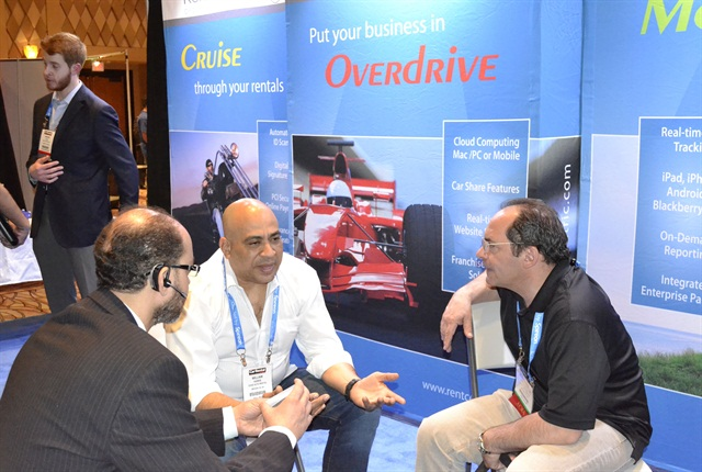 Car rental attendees interacted with vendors in the exhibit hall.