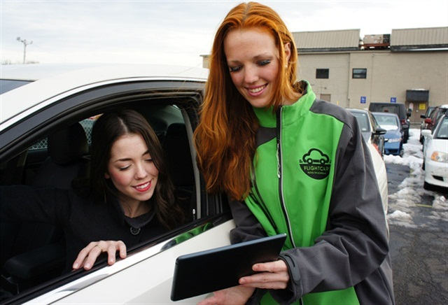 A FlightCar rep helps a customer. Photo courtesy of FlightCar.