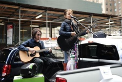 Singer Chloe Temtchine performs from the back of an Enterprise CarShare vehicle during a traveling concert series to benefit the Pulmonary Hypertension Association in New York City. Photo courtesy of Enterprise Holdings.
