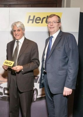 Michel Taride, president of Hertz International, and Sean Boland, managing director of Hertz Ireland and company director of Ryan's Investments, extend their franchise partnership. Photo credit: The Hertz Corp.