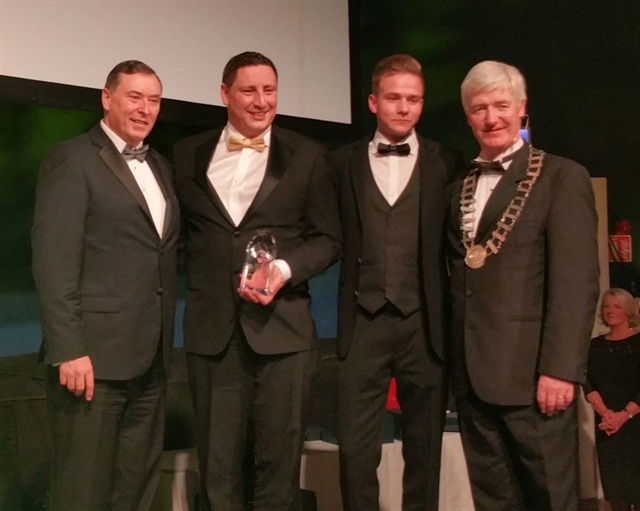 Michael Rienhoff and Paul Manning from Hertz Ireland (center) accept the award from Stephen Sands of Riviera Travel (left) and Martin Skelly, president of the Irish Travel Agents Association (right).