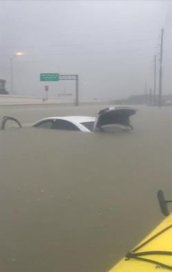 Johneishia, an employee at Airport Van Rental's location in Houston, had to be rescued from her car. Photo courtesy of Airport Van Rental.