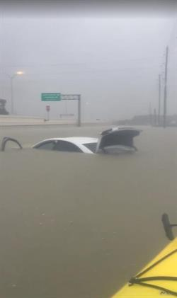 Johneishia, an employee at Airport Van Rental's location in Houston, had to be rescued from her car. She lost her car and her home was completely flooded.