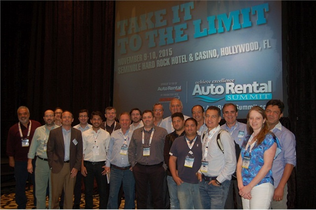 Chris Brown, executive editor of Auto Rental News, poses with the delegation of 23 rental car executives from Brazil during the 2015 Auto Rental Summit. Photo by Amy Winter-Hercher