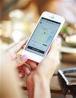 A Uber user requests a ride through the app. Photo courtesy of Uber.