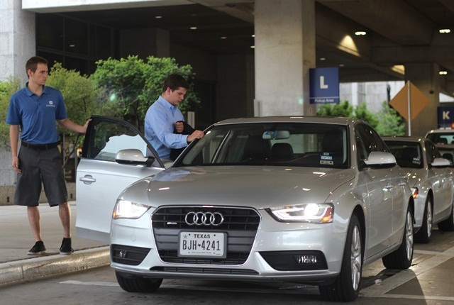 A customer at Silvercar's location at Austin Bergstrom International Airport is guided to his car by Silvercar's curbside valet service. Photo credit: Silvercar.