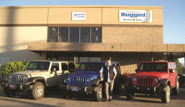 Chad Knavel, vice president and general manager of Rugged Rental, poses with some of the company's fleet vehicles. Rugged Rental was named the overall winner of the 2017 Renter Rated Program Award. Photo courtesy of Rugged Rental.
