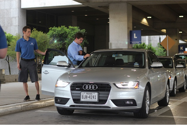 A customer at Silvercar's location at Austin Bergstrom International Airport is guided to his car by Silvercar's curbside valet service. Photo credit: Silvercar