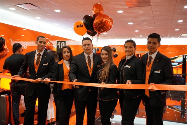 Sixt employees cut the ribbon at the Miami location's launch party. Photo courtesy of Sixt.