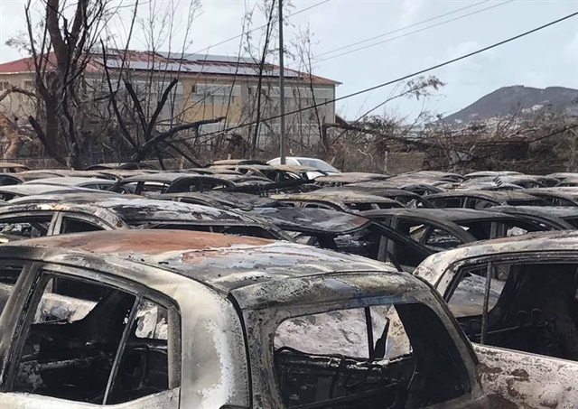 Sixt vehicles at its St. Maarten location were parked and secured, but after Hurricane Irma hit, looting took place. People syphoned gas out of parked cars, leaving fuel trails everywhere. It appears a spark from down electrical lines ignited the place and the cars. Photo courtesy of Sixt.