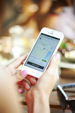 A customer requests a ride through Uber's mobile app. Photo courtesy of Uber.