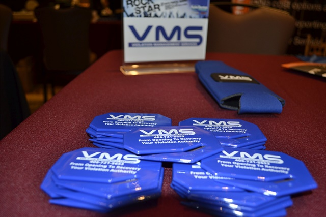 Violation Management Services' booth at the Auto Rental Summit conference. Photo by Amy Winter-Hercher.