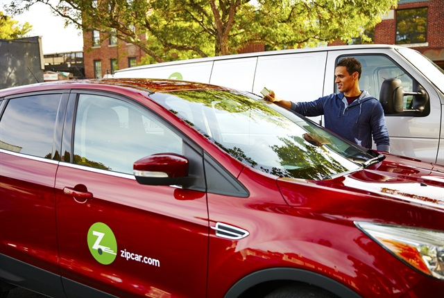 A Zipcar member taps his Zipcard to enter the vehicle. Photo courtesy of Zipcar.